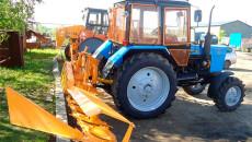 Фото: Трактор с косилкой